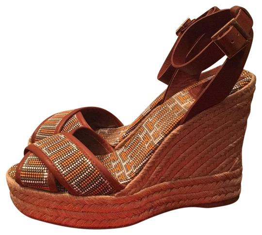 Preload https://item5.tradesy.com/images/tory-burch-brown-with-yellow-florian-wedges-size-us-9-regular-m-b-23491179-0-1.jpg?width=440&height=440