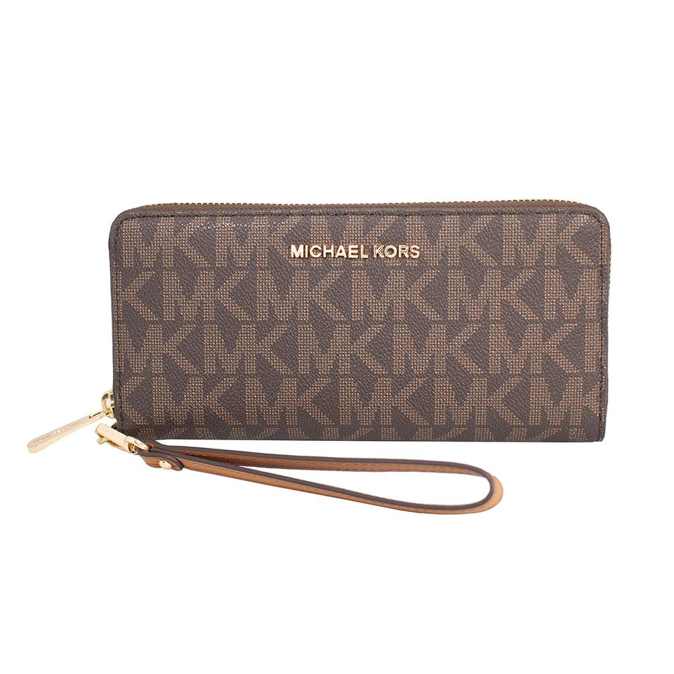 cf16f690c507c Michael Kors Brown Acorn Jet Set Travel Leather Continental Wristlet Wallet