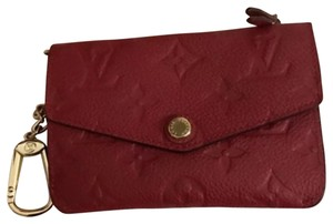 Louis Vuitton Wristlet in cerise