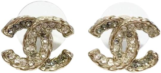 Preload https://img-static.tradesy.com/item/23494977/chanel-gold-grey-white-pierced-studs-cc-logo-and-clear-crystals-earrings-0-2-540-540.jpg