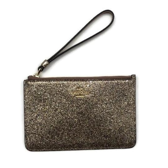 Preload https://img-static.tradesy.com/item/23495358/coach-small-glitter-gold-canvasleather-wristlet-0-0-540-540.jpg