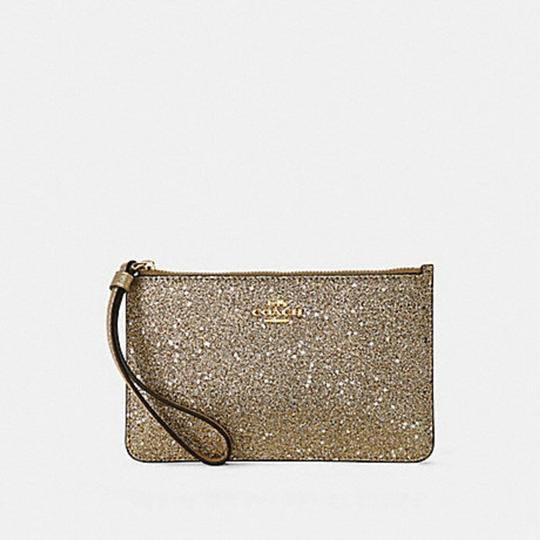 Coach Glitter Wristlet in gold