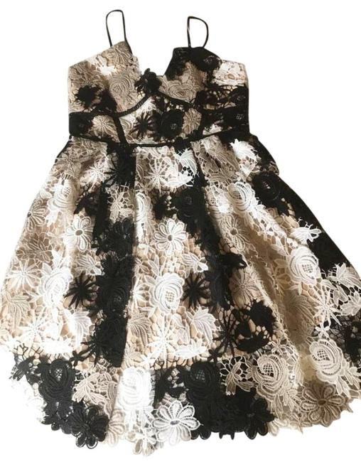 Romeo & Juliet Couture short dress Ivory Beige Black Embroidery Cutouts Multi Lace Design Contrast Lining Zip V-neck on Tradesy