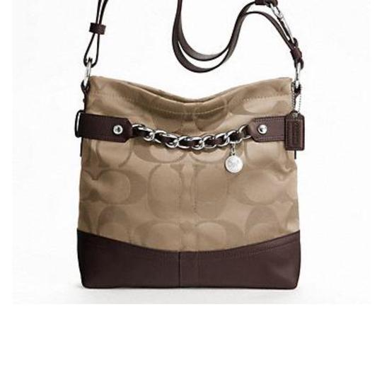 Preload https://img-static.tradesy.com/item/23496254/coach-signature-chain-duffle-f18862-brown-sateenleather-shoulder-bag-0-0-540-540.jpg