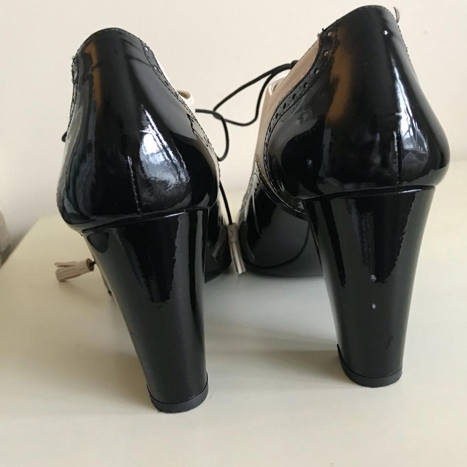 0d39b521f4c3 Bally Black and Creme Patent Leather Wingtip Heels Pumps Size US 7 ...