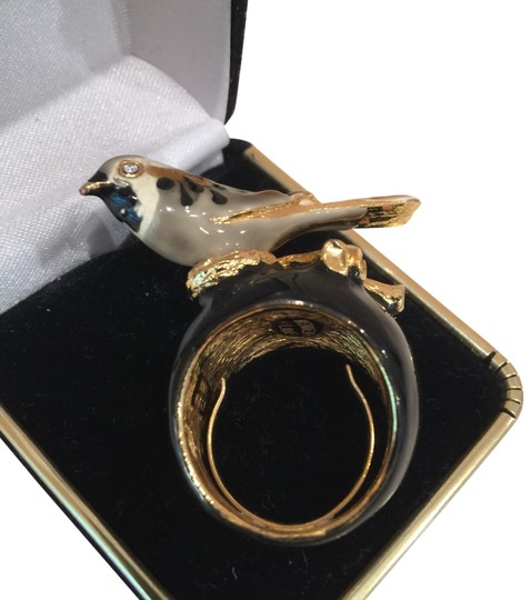 Preload https://img-static.tradesy.com/item/23518435/kenneth-jay-lane-black-enamel-base-with-bird-done-in-browns-and-taupe-perched-on-a-gold-branch-ring-0-1-540-540.jpg