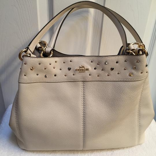 Preload https://img-static.tradesy.com/item/23519030/coach-lexy-stardust-studs-chalklight-gold-pebbled-leather-shoulder-bag-0-0-540-540.jpg