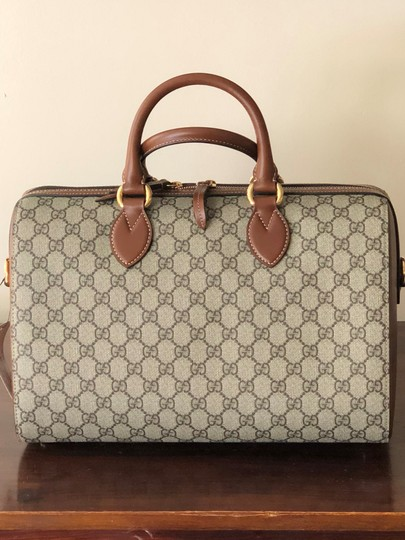 Preload https://img-static.tradesy.com/item/23519132/gucci-boston-top-handle-supreme-brown-leather-satchel-0-0-540-540.jpg