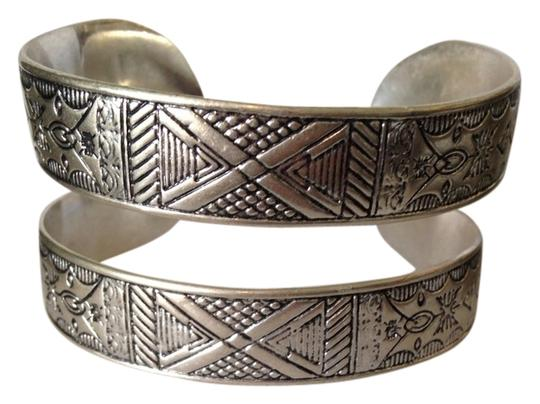 Preload https://item5.tradesy.com/images/lucky-brand-silver-nwot-silver-tone-aztec-design-cuff-bracelet-2352469-0-0.jpg?width=440&height=440