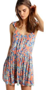 Free People short dress Coral, Blue Floral Ruffle Backless Sundress Mini on Tradesy