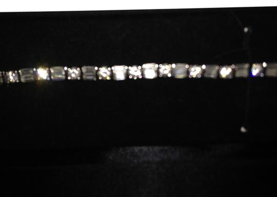 Sears This CZ STERLING SILVER Tennis Bracelet is by Sears. Has never been worn. Very Glittery and beautiful on. 7.5 inches.