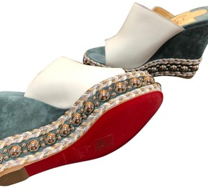 Christian Louboutin white leather with light turquoise suede heels with silver studs and tri-colored metallic braided threads. Amazing workmanship! Mules