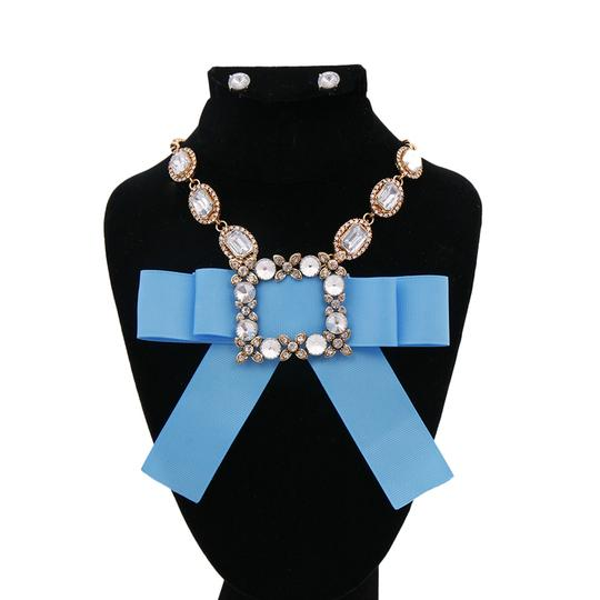 Preload https://img-static.tradesy.com/item/23543699/blue-clear-antique-gold-bow-rhinestone-and-crystal-necklace-0-0-540-540.jpg