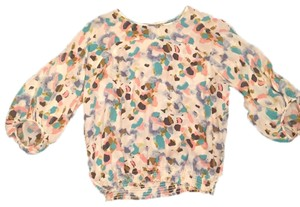 BCBGeneration Top Off-white, pink, olive green, blues and soft black.