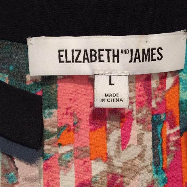 Elizabeth and James Top Multi---pinks, tans, black, greens, taupes.