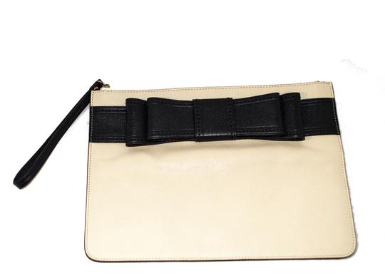 Preload https://img-static.tradesy.com/item/23545273/kate-spade-ivory-navy-leather-clutch-0-0-540-540.jpg