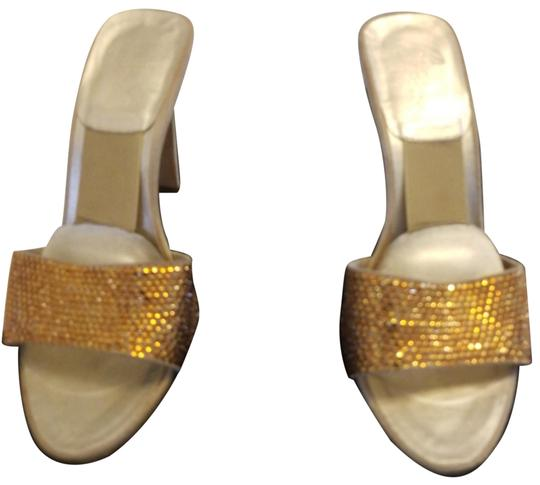 Preload https://item5.tradesy.com/images/versace-gold-and-taupe-crystal-slides-formal-shoes-size-eu-36-approx-us-6-regular-m-b-23545274-0-1.jpg?width=440&height=440