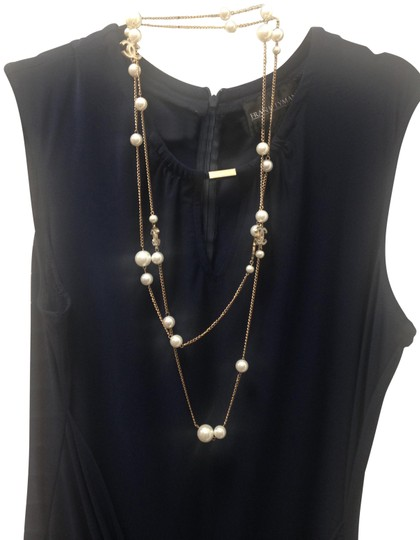 Preload https://item1.tradesy.com/images/gold-white-long-cc-tone-66-length-66-necklace-23545280-0-6.jpg?width=440&height=440