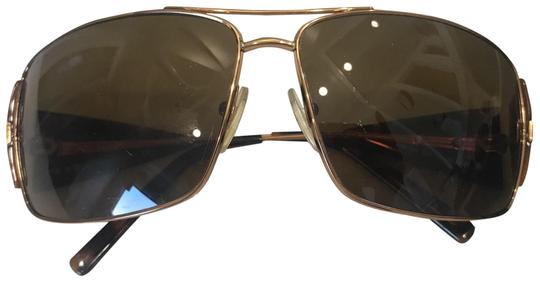 Preload https://img-static.tradesy.com/item/23545531/prada-goldbrown-sunglasses-0-1-540-540.jpg