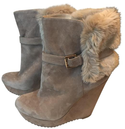Preload https://item1.tradesy.com/images/nine-west-tannude-leather-faux-fur-wedge-bootsbooties-size-us-10-regular-m-b-23545545-0-1.jpg?width=440&height=440