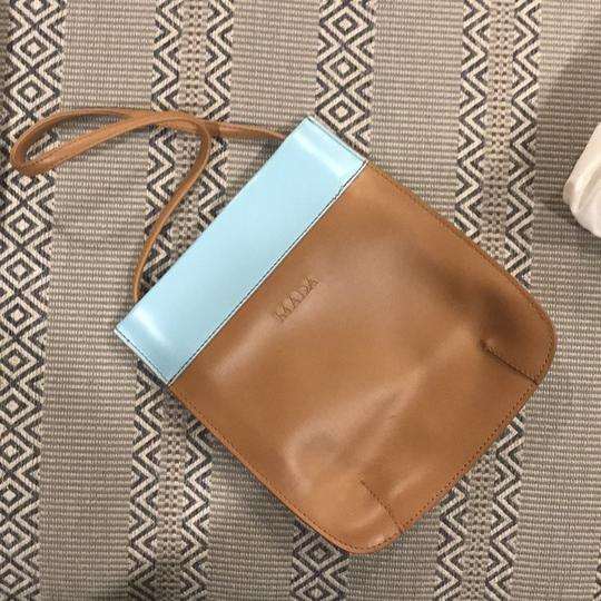 Mada Satchel in tan and aqua leather.