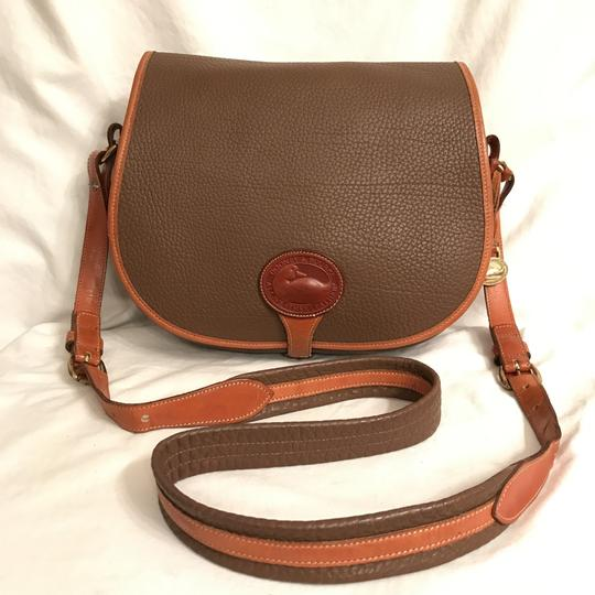 Preload https://item1.tradesy.com/images/dooney-and-bourke-rare-large-saddle-brown-tan-leather-cross-body-bag-23545650-0-0.jpg?width=440&height=440