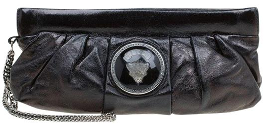Preload https://item4.tradesy.com/images/gucci-metallic-pop-night-wristlet-black-leather-clutch-23545748-0-1.jpg?width=440&height=440
