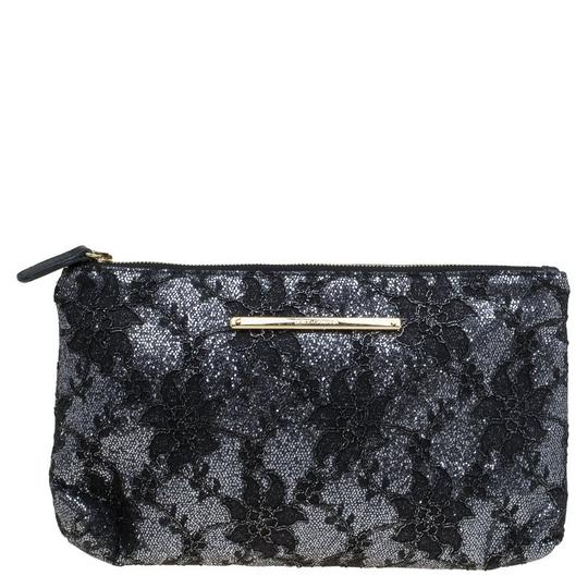 Preload https://item5.tradesy.com/images/dolce-and-gabbana-floral-black-fabric-clutch-23545804-0-0.jpg?width=440&height=440