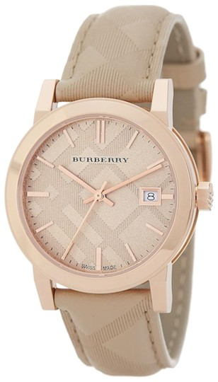 Preload https://item4.tradesy.com/images/burberry-tan-swiss-the-classic-round-trench-check-embossed-leather-strap-34mm-watch-23545823-0-1.jpg?width=440&height=440