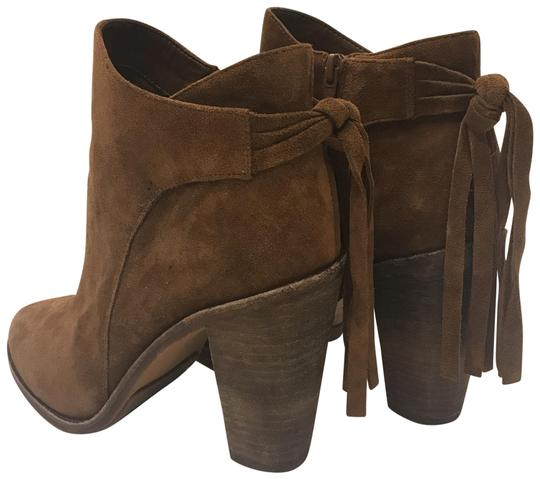 Preload https://item1.tradesy.com/images/vince-camuto-tan-suede-with-fringe-detail-bootsbooties-size-us-10-regular-m-b-23545825-0-1.jpg?width=440&height=440