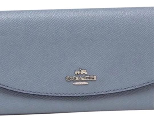 Preload https://img-static.tradesy.com/item/23545925/coach-blue-slim-envelope-wallet-0-1-540-540.jpg