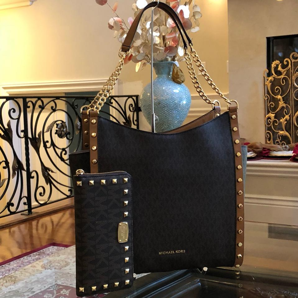 92a70c1c976d Michael Kors Monogram Signature Studded Summer Tote in Brown Image 0 ...