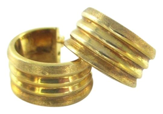 Preload https://item1.tradesy.com/images/gold-14kt-yellow-ribbed-huggies-hoop-37-grams-made-italy-mothers-day-earrings-2354770-0-0.jpg?width=440&height=440