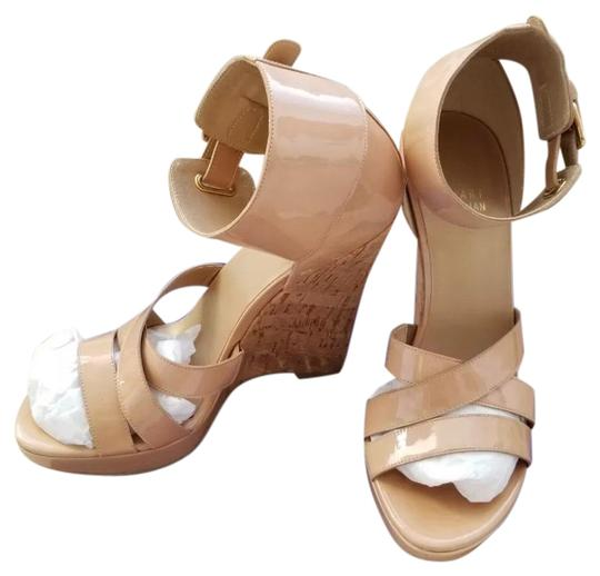 Preload https://img-static.tradesy.com/item/23566347/stuart-weitzman-nude-hilda-sandals-wedges-size-us-7-regular-m-b-0-1-540-540.jpg