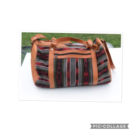 Preload https://item1.tradesy.com/images/duffle-multi-color-leather-and-fabric-weekendtravel-bag-23566840-0-0.jpg?width=440&height=440