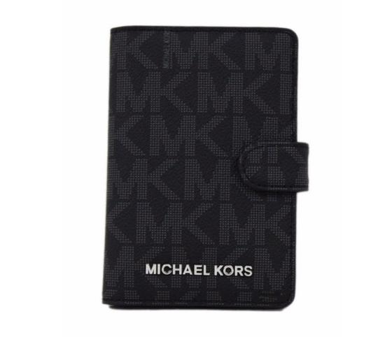 Preload https://item1.tradesy.com/images/michael-kors-jet-set-logo-passport-case-wallet-holder-purse-black-canvas-clutch-23567450-0-0.jpg?width=440&height=440