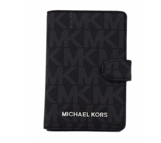 Preload https://img-static.tradesy.com/item/23567456/michael-kors-jet-set-passport-case-wallet-holder-purse-black-logo-leather-cross-body-bag-0-0-540-540.jpg