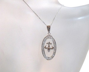 Sterling Silver Fleur De Lis oval pendant necklace with cz's