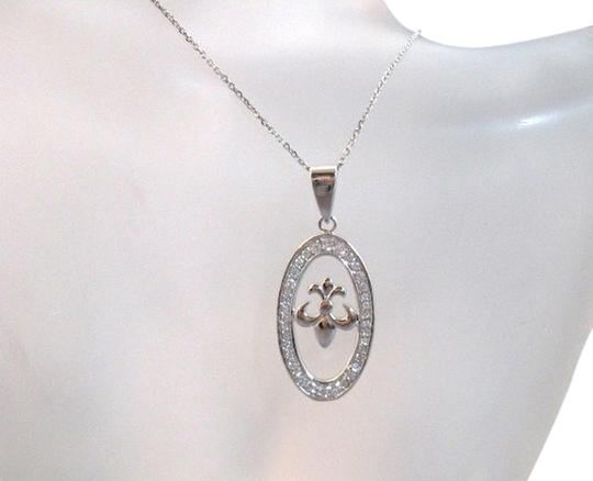 Preload https://img-static.tradesy.com/item/2357185/clear-sterling-silver-fleur-de-lis-oval-pendant-with-cz-s-necklace-0-0-540-540.jpg