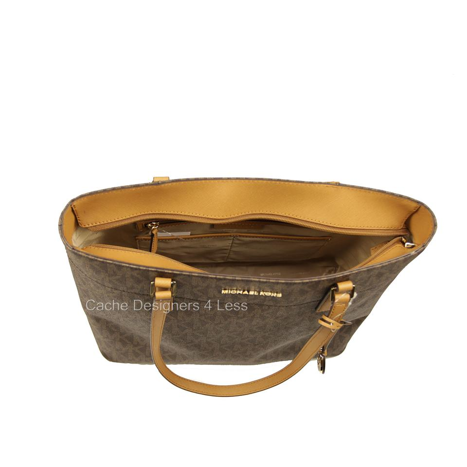 4a2e93f7c51a Michael Kors Morgan Large Brown Signature Pvc with Leather Hardware Tote -  Tradesy