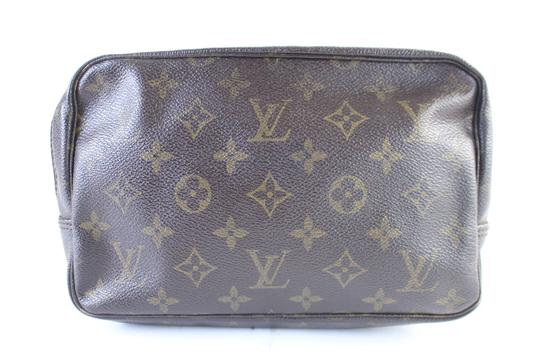 Preload https://img-static.tradesy.com/item/23578944/louis-vuitton-trousse-monogram-23-8lz0625-brown-coated-canvas-clutch-0-0-540-540.jpg