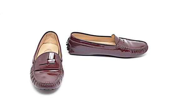 Preload https://img-static.tradesy.com/item/23580028/tod-s-wine-patent-leather-penny-loafers-signature-rubber-pebble-soles-flats-size-eu-365-approx-us-65-0-0-540-540.jpg