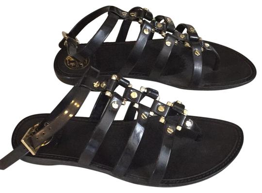 Preload https://img-static.tradesy.com/item/23585344/tory-burch-chocolate-brown-grommet-gladiator-sandals-flats-size-us-65-regular-m-b-0-1-540-540.jpg