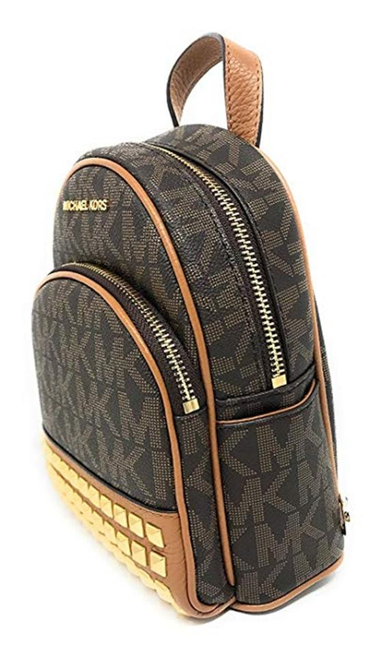 54507305bc78 Michael Kors Abbey Extra-small Signature Studded Brown Acorn Backpack -  Tradesy