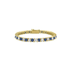 DesignerByVeronica Sapphire Created and Cubic Zirconia Tennis Bracelet in Yellow Vermeil.