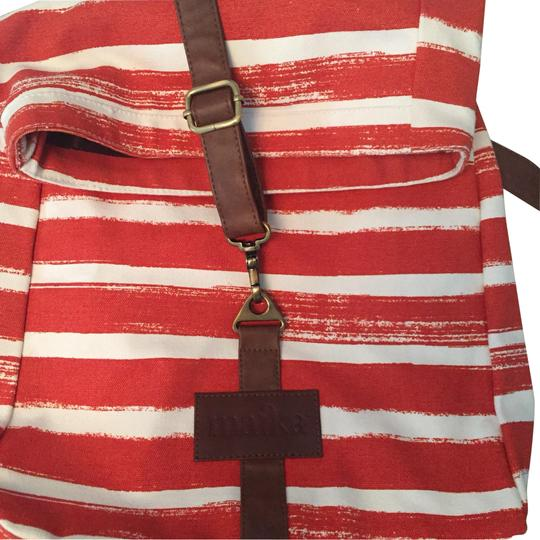 Preload https://img-static.tradesy.com/item/23589141/burnt-orange-baise-canvas-brown-leather-with-trim-backpack-0-1-540-540.jpg
