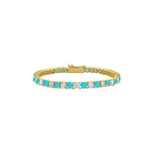 DesignerByVeronica Created Blue Topaz and CZ Tennis Bracelet in Yellow Vermeil. 5 CT. TGW