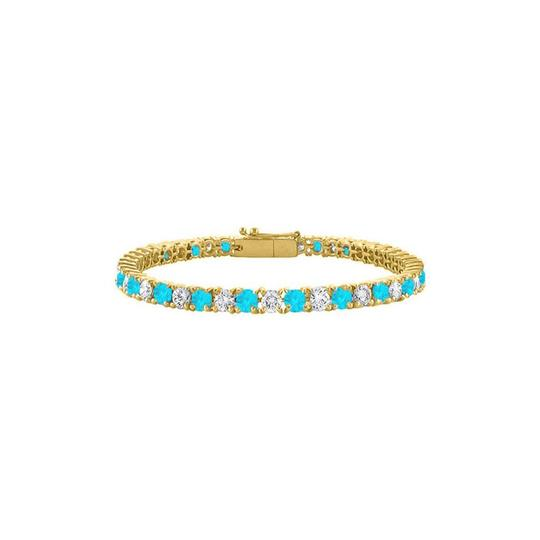 Preload https://img-static.tradesy.com/item/23589726/blue-created-topaz-and-cz-tennis-yellow-vermeil-5-ct-tgw-bracelet-0-0-540-540.jpg