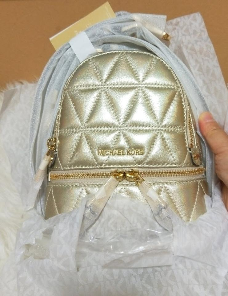 c926a069c3587 Michael Kors Rhea Mini Metallic Quilted Crossbody Pale Gold Leather Backpack