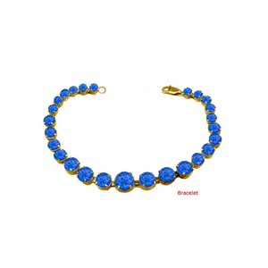 DesignerByVeronica September Birthstone Prong Set Sapphire Bracelet in Yellow Silver